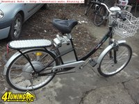Bicicleta cu motor electric
