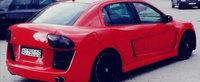 """A ajuns vedeta pe internet. Un roman isi vinde masina, un Opel Astra """"model unicat"""" si """"cipat"""""""