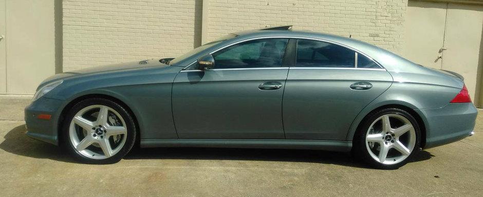 Are 470 CP sub capota, insa costa cat o Dacie Logan. Uite cu cat se vinde acest Mercedes CLS55 AMG