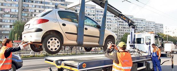 Atentie, soferi! Hingherii de masini se intorc, soferul va plati 500 de lei sa-si recupereze masina parcata neregulamentar