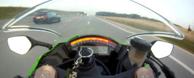 Audi RS6 Avant versus Kawasaki ZX-10R - Intrecere pe autostrada la peste 300 km/h
