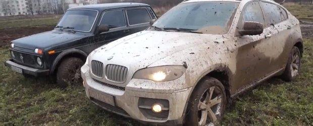 BMW X6 vs. Lada Niva: masina de oras si masina de povara