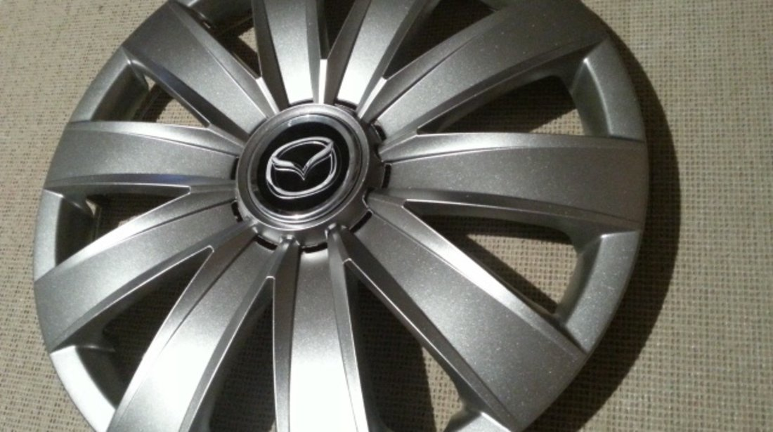 Capace Mazda r14 la set de 4 bucati cod 226