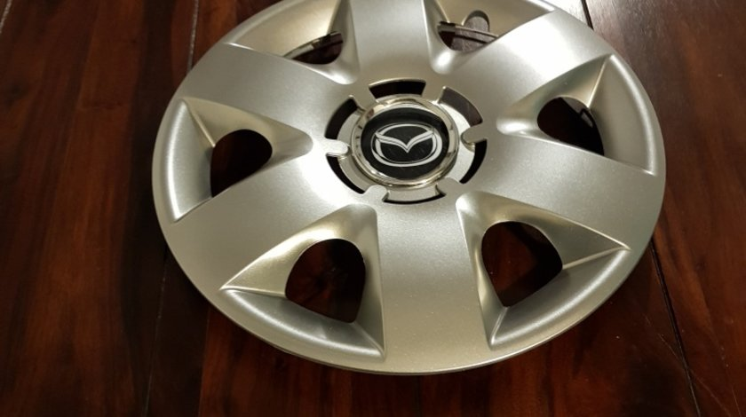 Capace Mazda r15 la set de 4 bucati cod 310