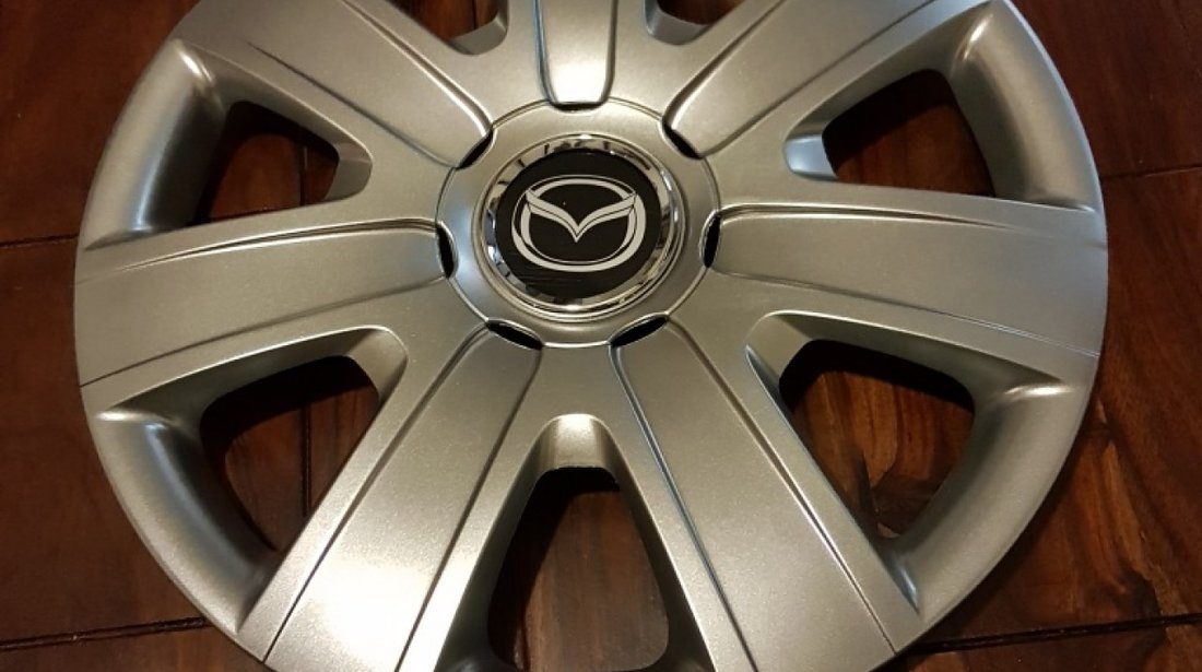 Capace Mazda r15 la set de 4 bucati cod 325