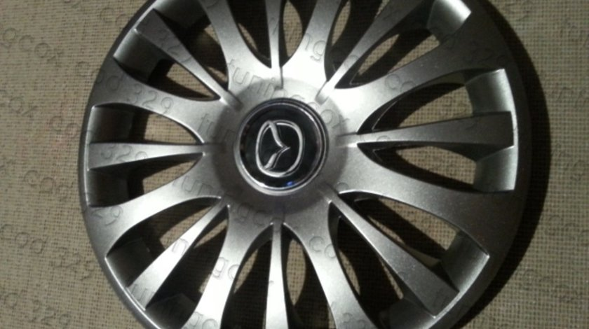 Capace Mazda r15 la set de 4 bucati cod 329