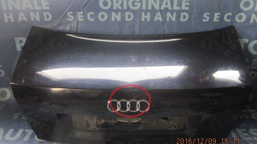 Capota spate Audi A4 (putin infundat deasupra la emblema)