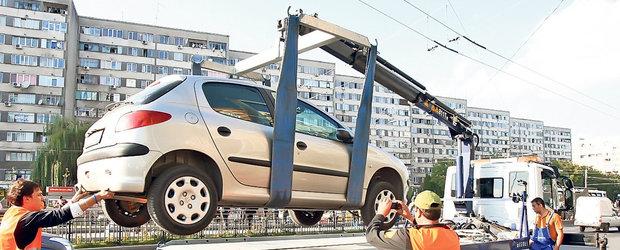Cum a aratat prima zi de ridicat masini parcate neregulamentar: circ ieftin si legea nu-i aceeasi pentru toata lumea