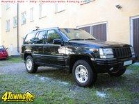Dezmembrari Jeep Grand Cherokee 5 2i V8 an 1997 5216 cmc 156 kw 212 cp tip motor Y01 motor benzina