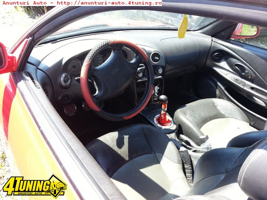 Dezmembrez Hyundai Coupe motor 2 0 benzina an 2001