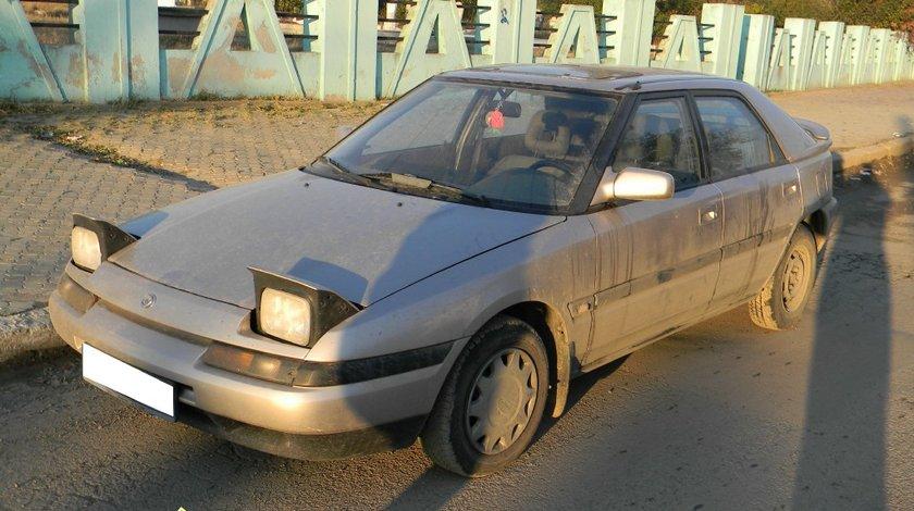 Dezmembrez Mazda 323 BG hatchback 1 6 16V 65KW 88 CP an fab 1992