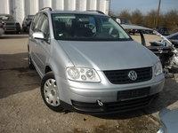 Dezmembrez VW Touran, volan stanga, 2.0tdi, AZV, 136cp