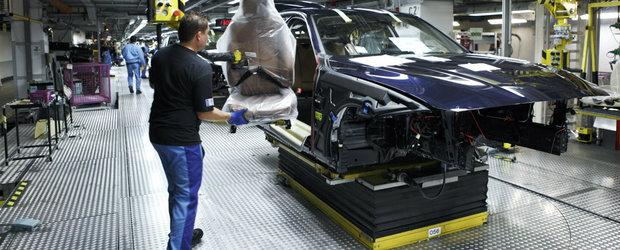 Dorel are rude in Germania. Doi angajati BMW au baut pana au cazut lati