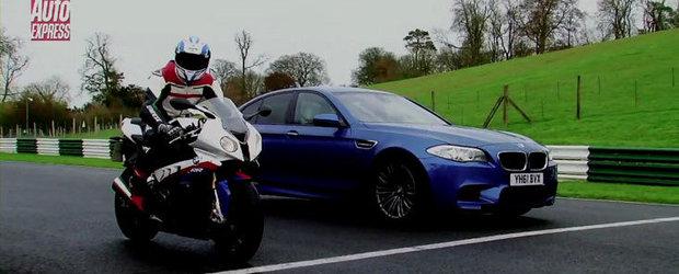 Duel pe circuit: BMW M5 versus BMW S1000RR