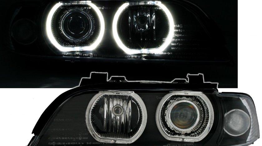 Faruri BMW seria 5 E39 cu lupa si angel eyes model NOU F30 look