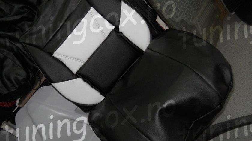Husa auto imitatie de piele de culoare neagra cu alb
