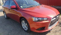 Maner usa stanga fata Mitsubishi Lancer 2010 hatch...