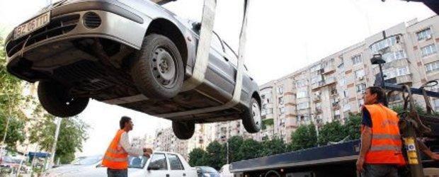 Masina ridicata, banii luati si parcari insuficiente
