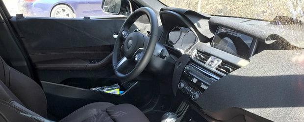 Noua masina cu tractiune fata de la BMW a fost surprinsa in teste. Cum arata interiorul. FOTO