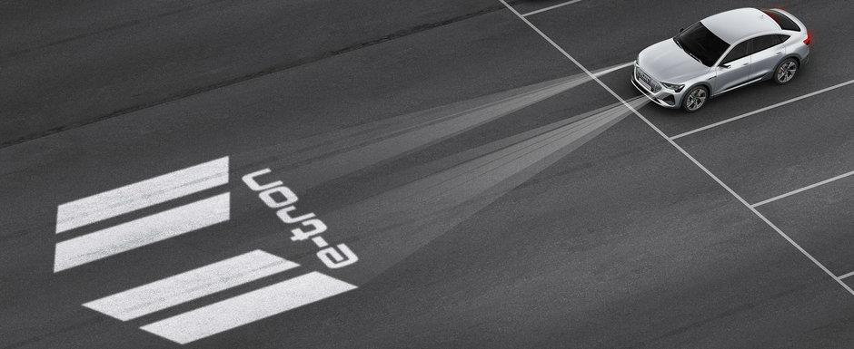 Noua masina de serie de la Audi are faruri care proiecteaza animatii pe asfalt. VIDEO ca sa te convingi si singur