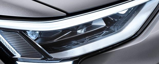 Noua masina de serie de la Audi e la ani lumina in fata rivalilor: are faruri care proiecteaza animatii pe asfalt. Cat costa in Romania