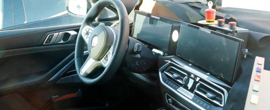 Noul BMW X6, surprins pentru prima oara in teste. SUV-ul bavarezilor a fost fotografiat cu doua ecrane curbate in bord