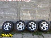 Ocazie set de 4 jante marca RC Design pentru Ford Kuga 5x108 cu tot cu anvelope de iarna marimea 235 60 R16 la doar 500 EURO