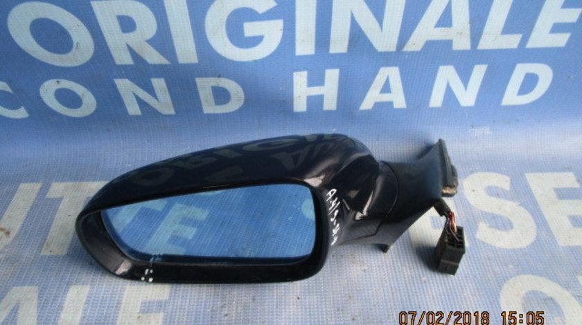 Oglinda retrovizoare  Audi A4 ; E1010480  (electrica , carcasa fisurata)