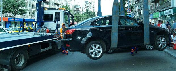 Parlamentarii vin cu lamuriri in cazul ridicarii masinilor parcate neregulamentar