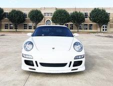 Porsche 911 cu scaun sofer central