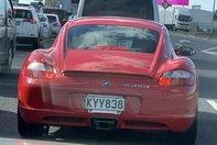 Porsche Cayman cu logo M318i