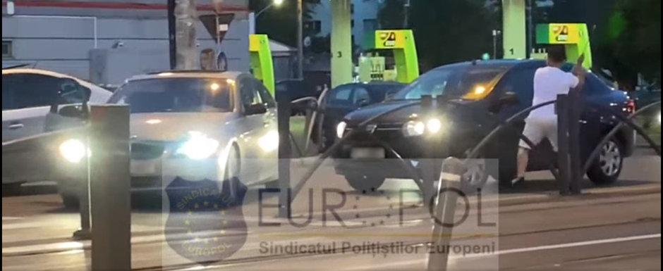 Scene incredibile in trafic. Momentul in care soferul unui BMW sparge cu crosa de golf geamul unei Dacii