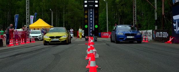 Scurta liniuta intre un BMW M4 si un BMW M5, ambele modificate