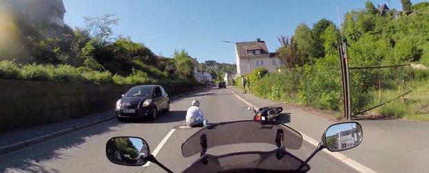 Scuterist lovit de un sofer in Germania, soferul este prins de un motociclist