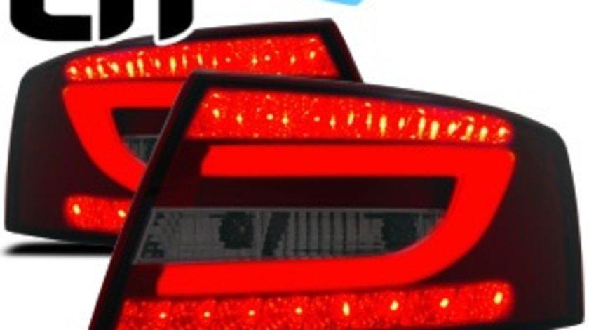 Stopuri Audi A6 4F rosu/fumuriu