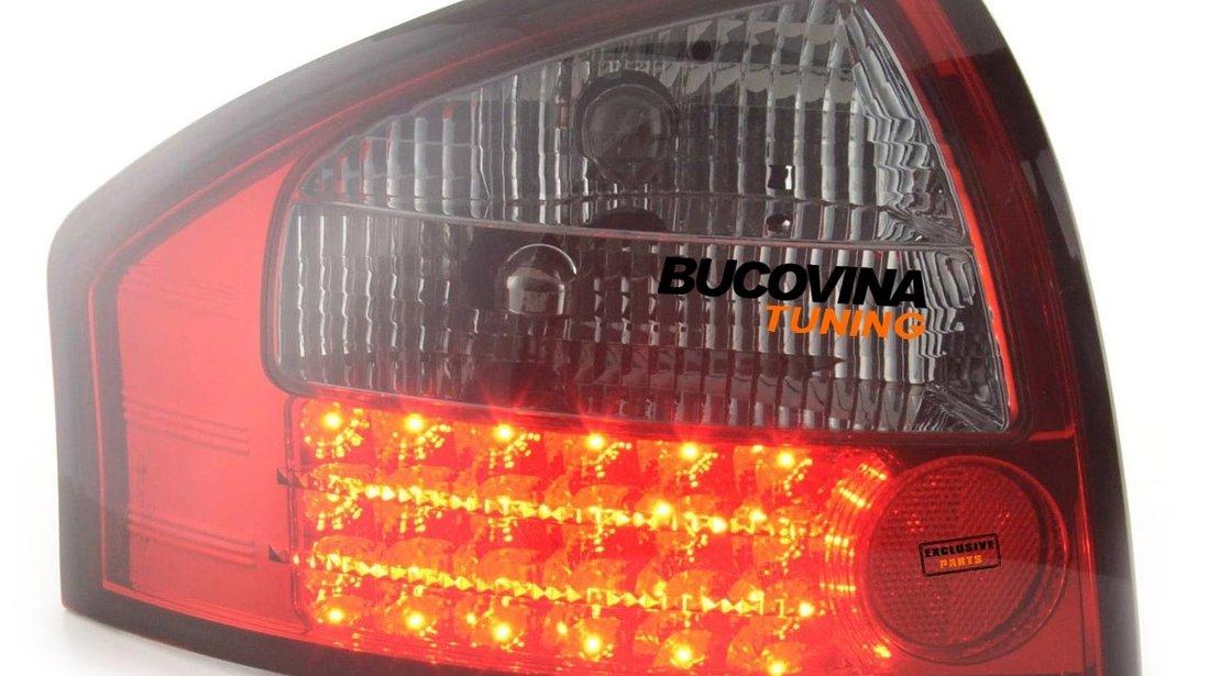 STOPURI LED AUDI A6 4B LIMOUSINE (97-04) - FUNDAL ROSU FUMURIU