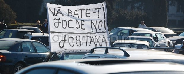 Taxa Auto se apropie de varianta finala: se va plati si la masinile inscrise RO