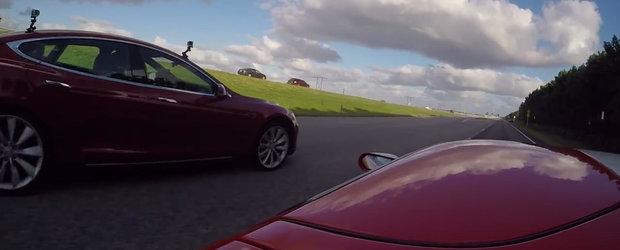 Tesla P90D si Ford GT incing autostrada cu doua curse ilegale