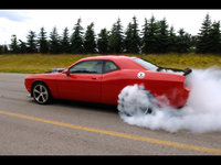 Click image for larger version  Name:2009-Dodge-Challenger-SRT10-Concept-Rear-And-Side-Smoke-1280x960.jpg Views:68 Size:352.6 KB ID:1190310
