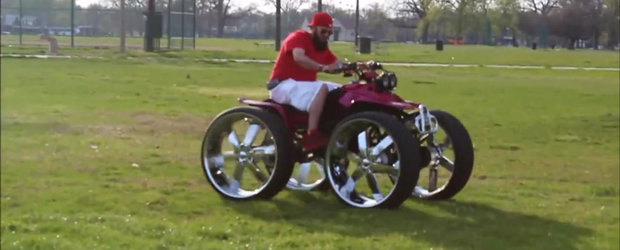 Un ATV cu roti de 28 inch face cerculete la un picnic
