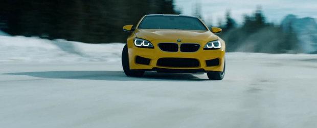 Un BMW M6 se dezlantuie pe gheata si zapada in mijlocul padurii plina de lupi