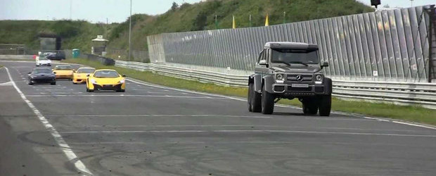 Un Mercedes G63 6x6 da buzna pe circuit, printre zeci de supercaruri