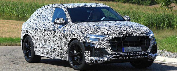 Versiunea sportiva a noului Audi Q8 a fost surprinsa in teste. Va avea doua motoare sub capota ca sa bata BMW X6